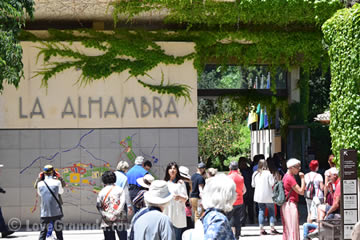 alhambra entrance with people waiting to buy tickets