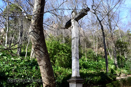 entrance to the alhambra forest and the cross
