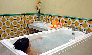 woman is relaxing in a small bath