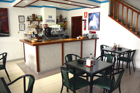cafee shop with tables and chairs in hostel velilla