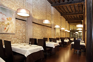 interior with tables in the grill restaurant in plaza bib rambla