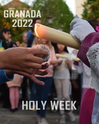 jesus wearing cross during holy week in granada