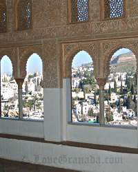alhambra decorations that represent arab history of granada and view of albaicin from windows