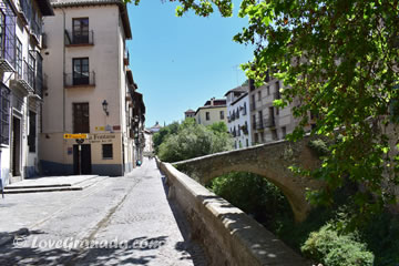 stone bridge across river darro